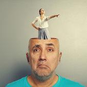 Depressed senior man and smiley woman — Stock Photo
