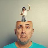 Depressed senior man and screaming woman — Stock Photo