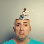 Depressed senior man with screaming businesswoman — Stock Photo