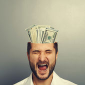 Screaming businessman with money  — Stock Photo