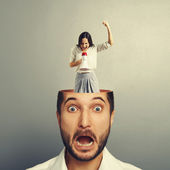 Stressed businessman with screaming woman — Stock Photo
