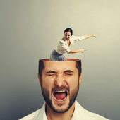 Stressed man with screaming woman — Stock Photo