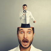 Stressed young man with angry screaming man — Foto de Stock