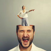 Stressed screaming man and smiley woman — Stock Photo