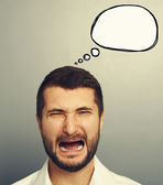 Crying man with empty speech balloon — Stockfoto