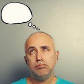 Bored senior man with speech bubble — Stock Photo