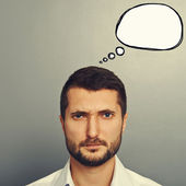 Frowning man with speech bubble — Stock Photo