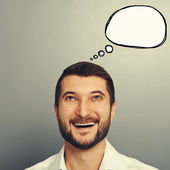 Laughing man with empty speech bubble — Stock Photo