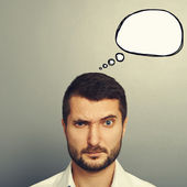 Pensive man with speech bubble — Stock Photo