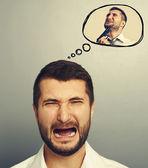 Screaming man with speech balloon — Stock Photo