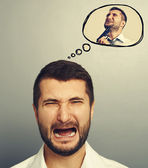 Screaming man with speech balloon — Stock Photo