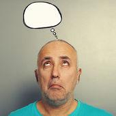 Senior man with speech bubble — Stock Photo