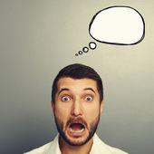 Shocked man with empty speech bubble — Stock Photo