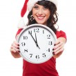 Excited girl with santa hat holding clock — Stock Photo #7673056