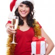 Cheerful young woman holding glass and gift — Stock Photo #8130135