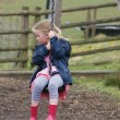 Stock Photo: Young Girl on Zip Wire