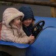 Two Little Girls in Barrel Go-Kart — Stock Photo #27892651