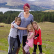 Mother and Children in Scottish Highlands - Beautiful Scenery — Stock Photo #27894607