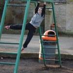 Young boy climbing on monkey bars — Stock Photo #43169823