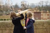 Three children discovering a telescope — Stock Photo