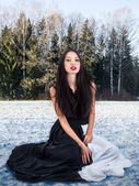 Fashion female in snow forest — Stock Photo