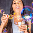 Latin Americfemale with soap bubbles — Stock Photo #16972085