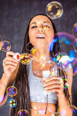 The Latin American female with soap bubbles — Stock Photo