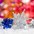 Christmas decorations in the snow — Stock Photo