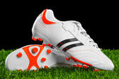 Soccer shoes on the green grass. — Stock Photo