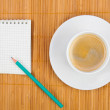 Blank notebook coffee cup on wooden background — Stock Photo