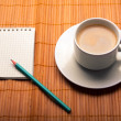 Blank notebook coffee cup on wooden background — Stockfoto