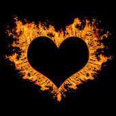 Fiery heart on black background. — Stock Photo