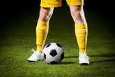 Soccer ball and a feet of a soccer player — Stockfoto