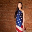 Woman in the American flag — Stock Photo