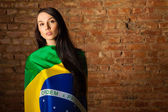 Woman in the Brazilian flag — Stock Photo
