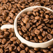 White mug of coffee in beans. — Stock Photo #25073191