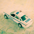Stock Photo: NYPD car and road map.