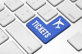 Buy tickets on the computer keyboard — Stock Photo