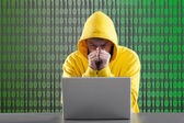Man in a yellow jacket working on the Internet — Stock Photo