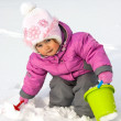 Little girl playing with snow — Stock Photo
