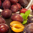 Plums in a sieve — Stock Photo