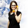 Woman using telephone — Stock Photo #10179696