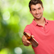 Young man holding a beer — Stock Photo #12665012
