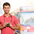 Portrait of a man holding camera — Stock Photo #12665040