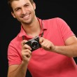 Portrait of a man holding camera — Stock Photo #12665052