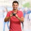 Portrait Of A Man Holding Camera — Stock Photo #12665058