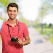 Portrait Of Man Holding Camera And Boarding Pass — Stock Photo #12665062