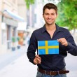 Potrait of a man holding flag — Stock Photo #12665124