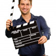A Young Man Holding A Clapboard - Foto Stock