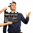 A Young Man Holding A Clapboard And Acting — Stock Photo #12665247